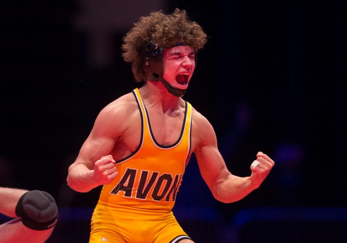 Avon High School's Asa Garcia reacts after winning the 126 lb. class over Columbus East High School's Cayden Rooks during the championship round of the 2018 IHSAA Wrestling State Tournament, Saturday, February 18, 2018, at Bankers Life Fieldhouse in Indianapolis.