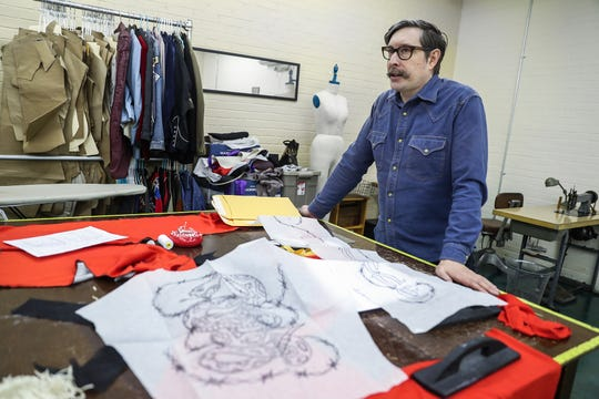 """Indianapolis tailor Jerry Lee Atwood talks with IndyStar at his studio in the Circle City Industrial Complex on Wednesday, Feb. 6, 2019. Atwood has sold custom-made suits to several notable musicians, including Post Malone. His chain stitch embroidery and flashy Western designs are reminiscent of 1950s-era """"Nudie"""" suits."""