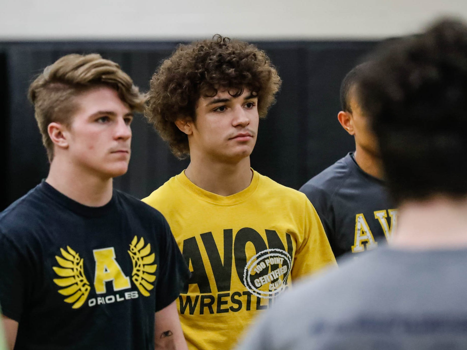 Avon wrestlers Asa Garcia, left, and Camden Chatterton, left, listen to the coach's instructions during a practice at Avon High School, on Monday, Jan. 11, 2019. Asa Garcia, an Avon H.S. senior and two-time state wrestling champ is chasing his third state title.