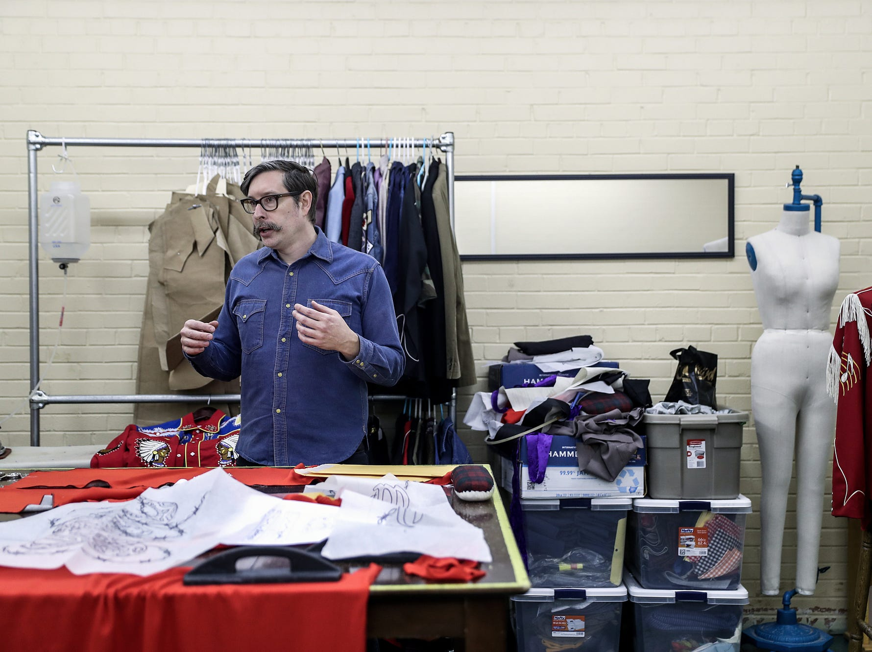 "Indianapolis tailor Jerry Lee Atwood talks with IndyStar at his studio in the Circle City Industrial Complex in Indianapolis on Wednesday, Feb. 6, 2019. Atwood has sold custom-made suits to several notable musicians, including Post Malone. His chain stitch embroidery and flashy Western designs are reminiscent of 1950s-era ""Nudie"" suits."