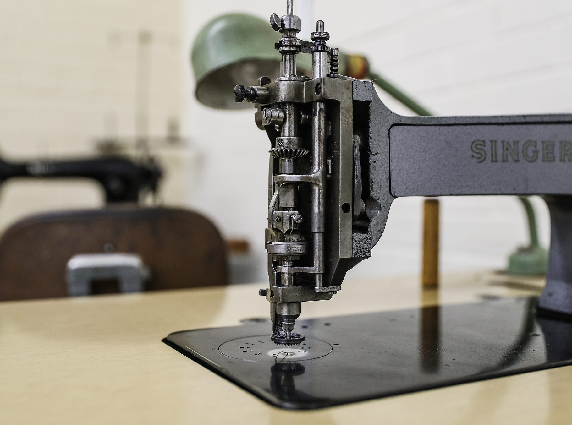 "One of several industrial sewing and embroidery machines is seen at Jerry Lee Atwood's studio in the Circle City Industrial Complex in Indianapolis on Wednesday, Feb. 6, 2019. Atwood has sold custom-made suits to several notable musicians, including Post Malone. His chain stitch embroidery and flashy Western designs are reminiscent of 1950s-era ""Nudie"" suits."