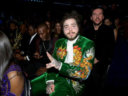 Post Malone wears a dragon-themed suit made by Indianapolis tailor Jerry Lee Atwood during Sunday's Grammy Awards show in Los Angeles.