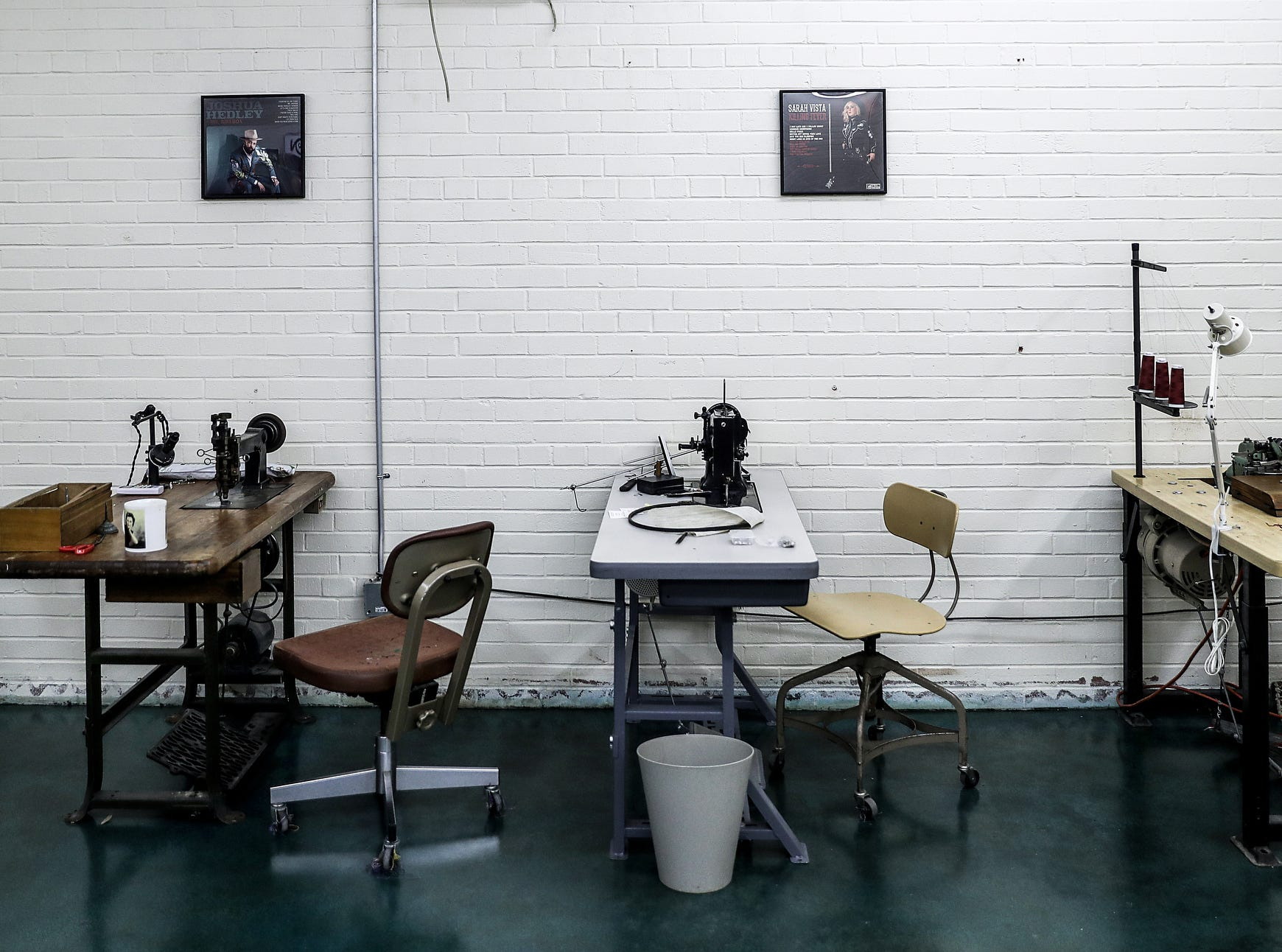 "Industrial sewing and embroidery machines line the wall of Jerry Lee Atwood's studio in the Circle City Industrial Complex in Indianapolis on Wednesday, Feb. 6, 2019. Atwood has sold custom-made suits to several notable musicians, including Post Malone. His chain stitch embroidery and flashy Western designs are reminiscent of 1950s-era ""Nudie"" suits."
