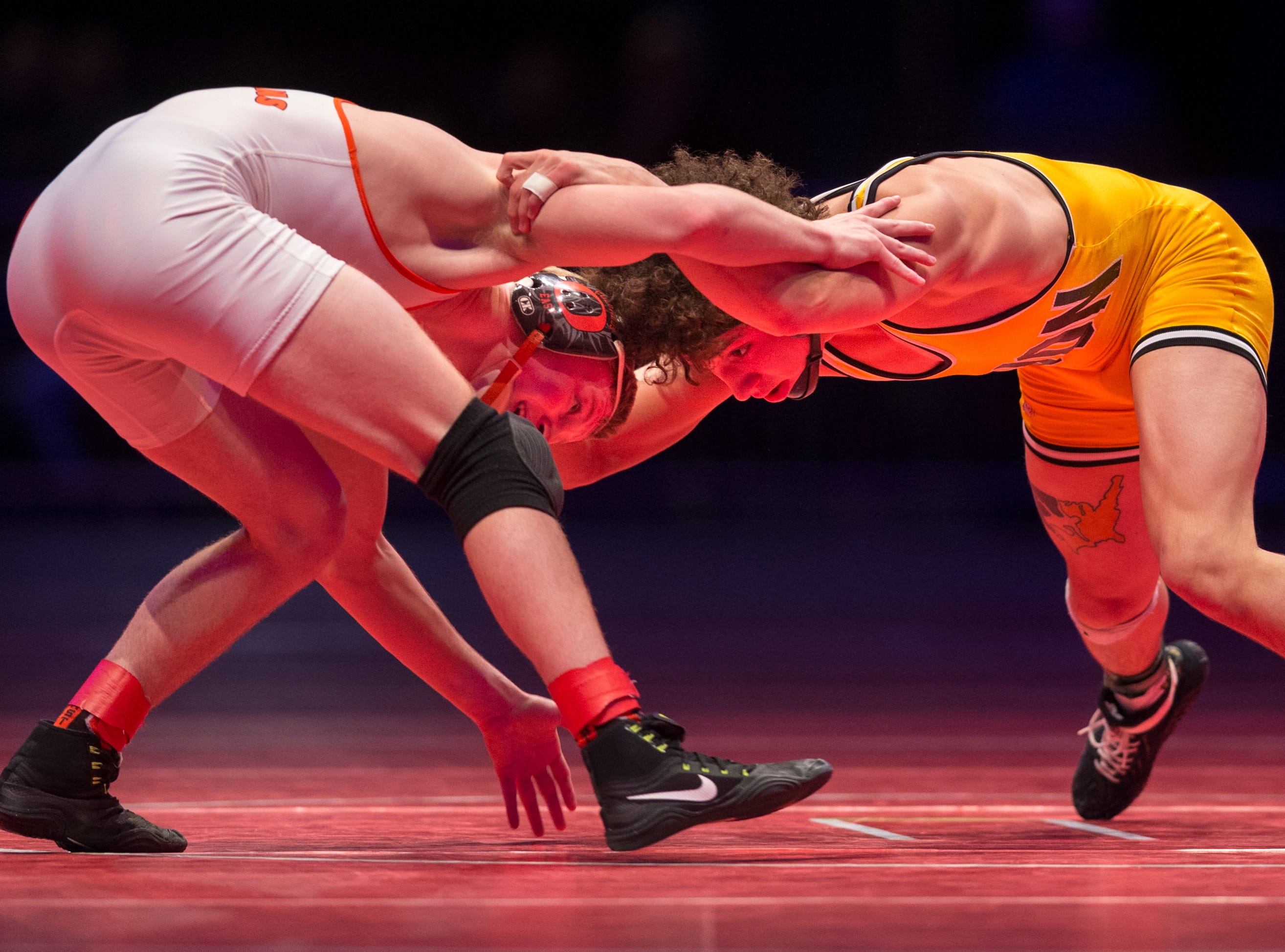 Avon High School's Asa Garcia, right, wrestles with Columbus East High School's Cayden Rooks in the 126 lb. class during the championship round of the 2018 IHSAA Wrestling State Tournament, Saturday, February 18, 2018, at Bankers Life Fieldhouse in Indianapolis.