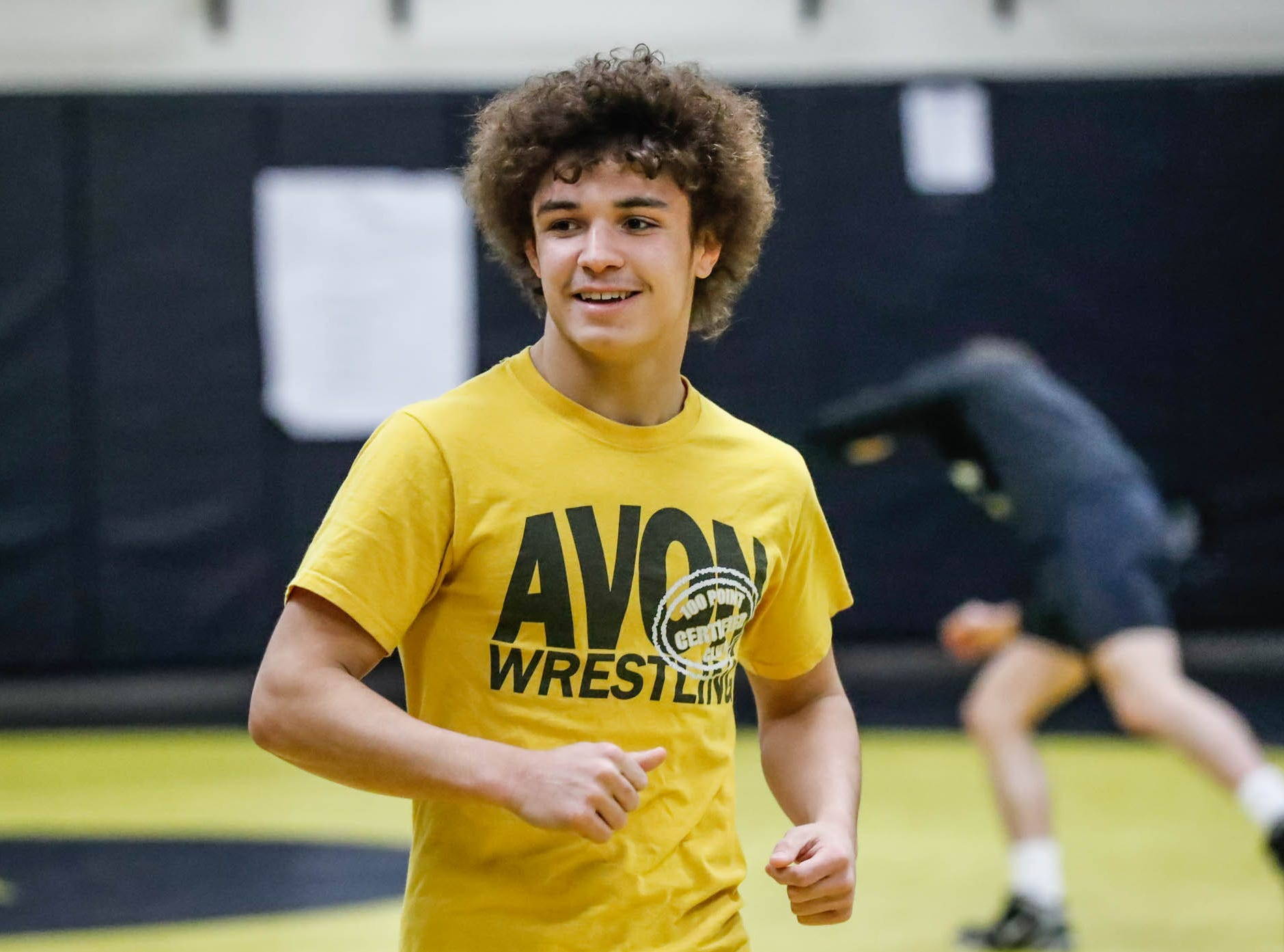 Avon wrestler Asa Garcia, center, runs warm up drills with his teammates during a team practice in the wrestling room at Avon High School, on Monday, Jan. 11, 2019. Asa Garcia, an Avon H.S. senior and two-time state wrestling champ is chasing his third state title.