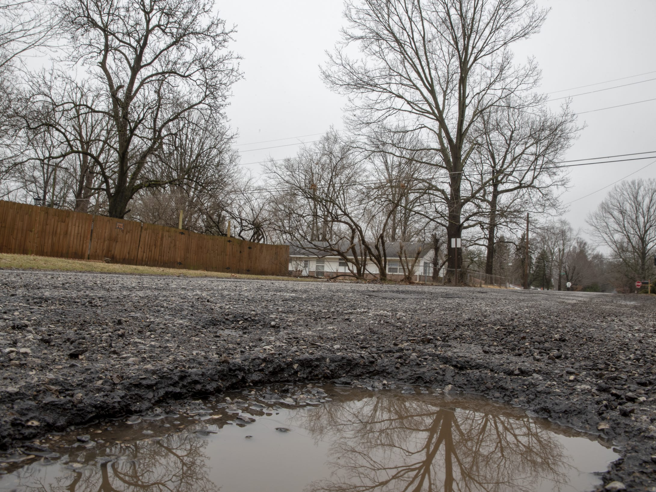 Potholes in Indianapolis: Residents cope with a fierce sense of humor