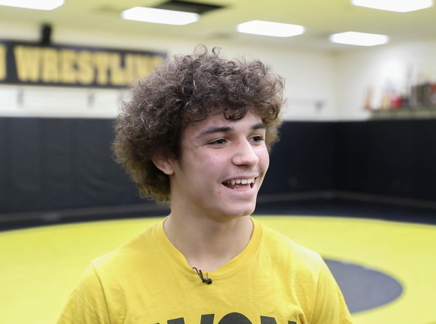 Avon wrestlers Asa Garcia is interviewed during a team practice in the wrestling room at Avon High School, on Monday, Jan. 11, 2019. Asa Garcia, an Avon H.S. senior and two-time state wrestling champ is chasing his third state title.