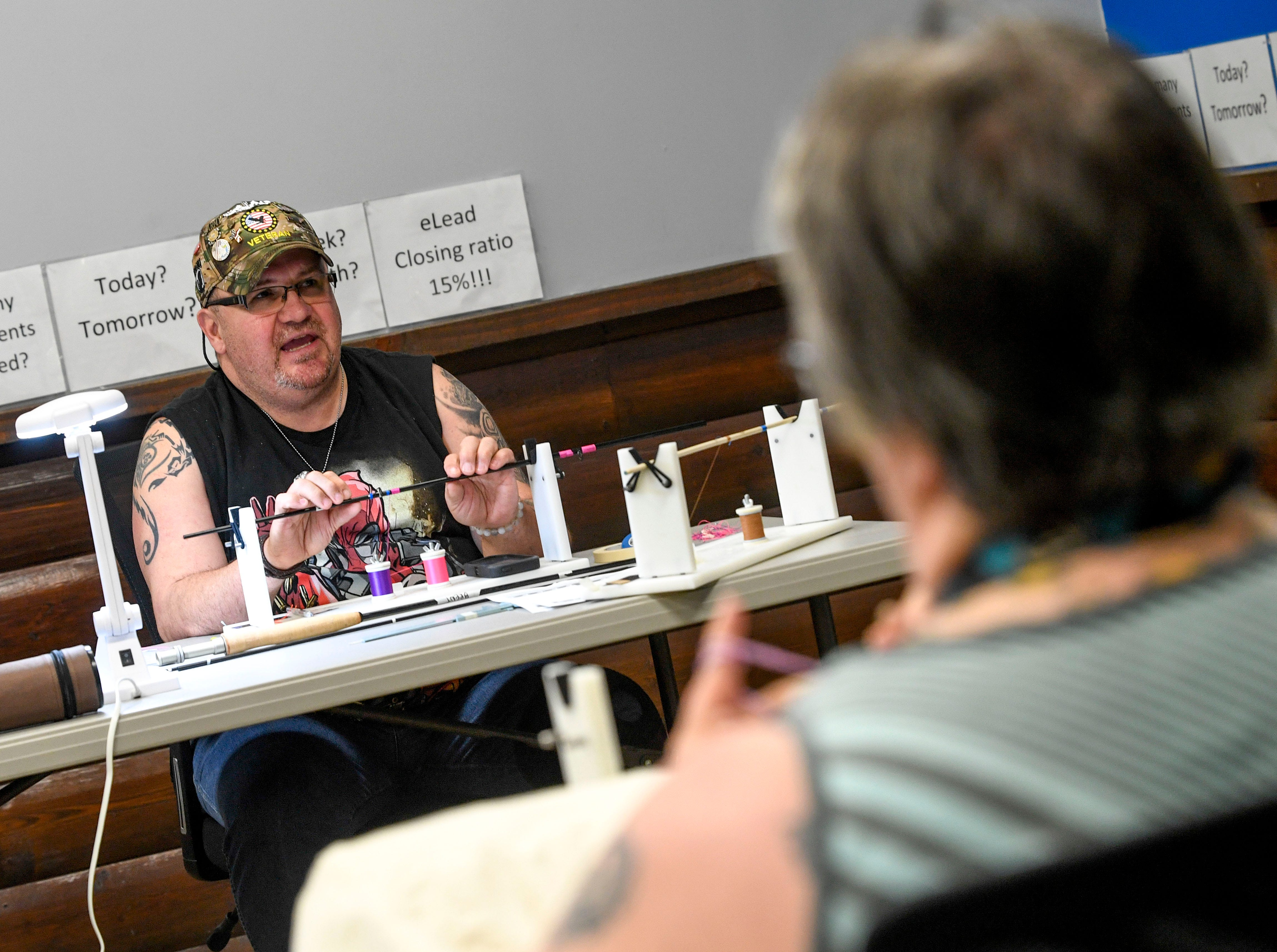 Brent Middleton, left, speaks with his wife, Wendy, about his life experiences while working on a fly fishing rod at Gander Outdoors in Jackson, Tenn., on Wednesday, Feb. 6, 2019.