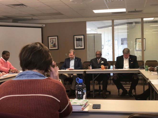 Reps. Chris Todd, R- Humboldt, and Johnny Shaw, D-Bolivar, and Sen. Ed Jackson await the start of a meeting with the Jackson-Madison County Schools System board.