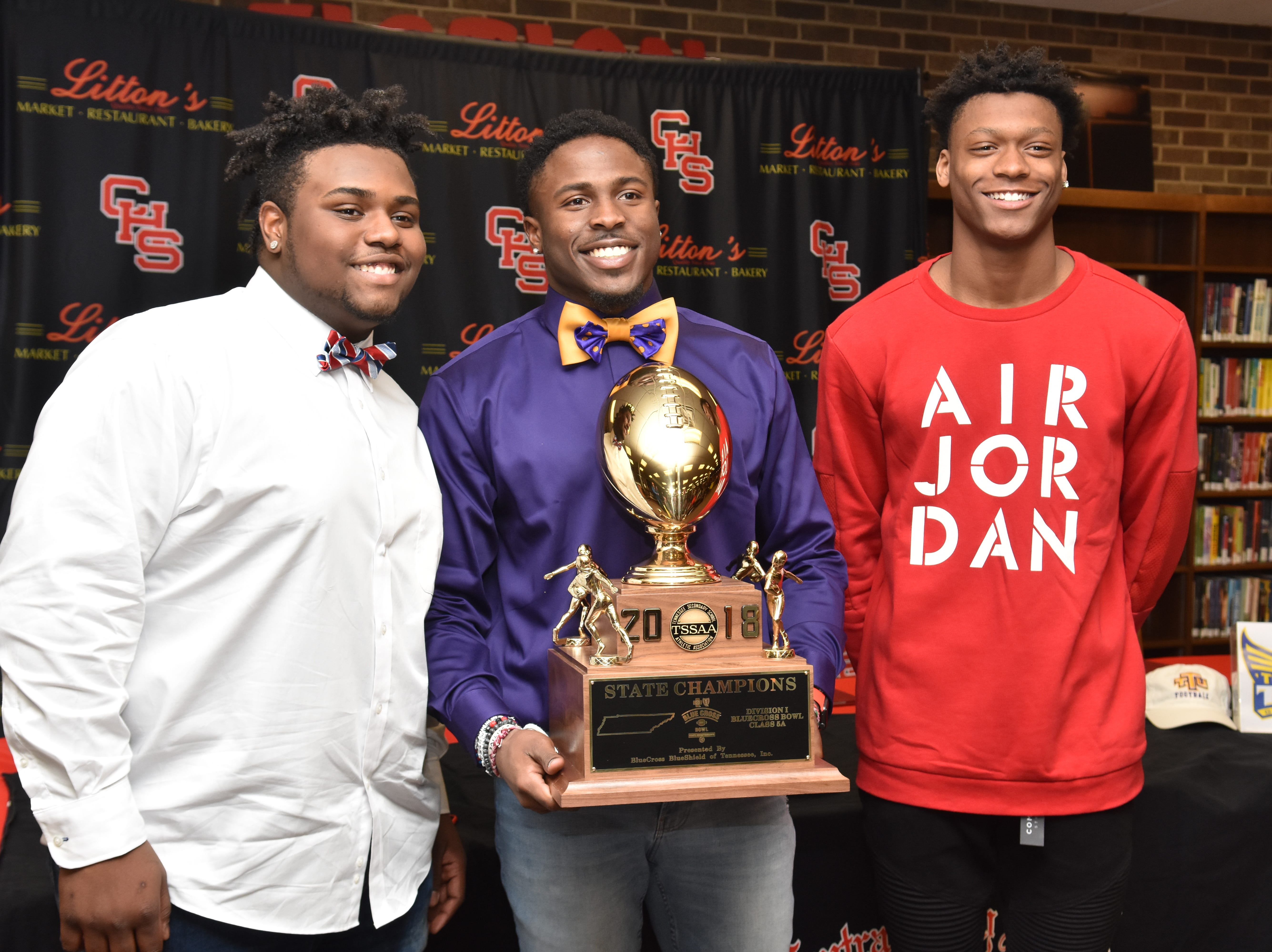 Jalynn Clemons, Xavier Washington and Demetrian Johnson, all Central seniors, signed letters of intent to play college football on Monday, Feb. 11, 2019.