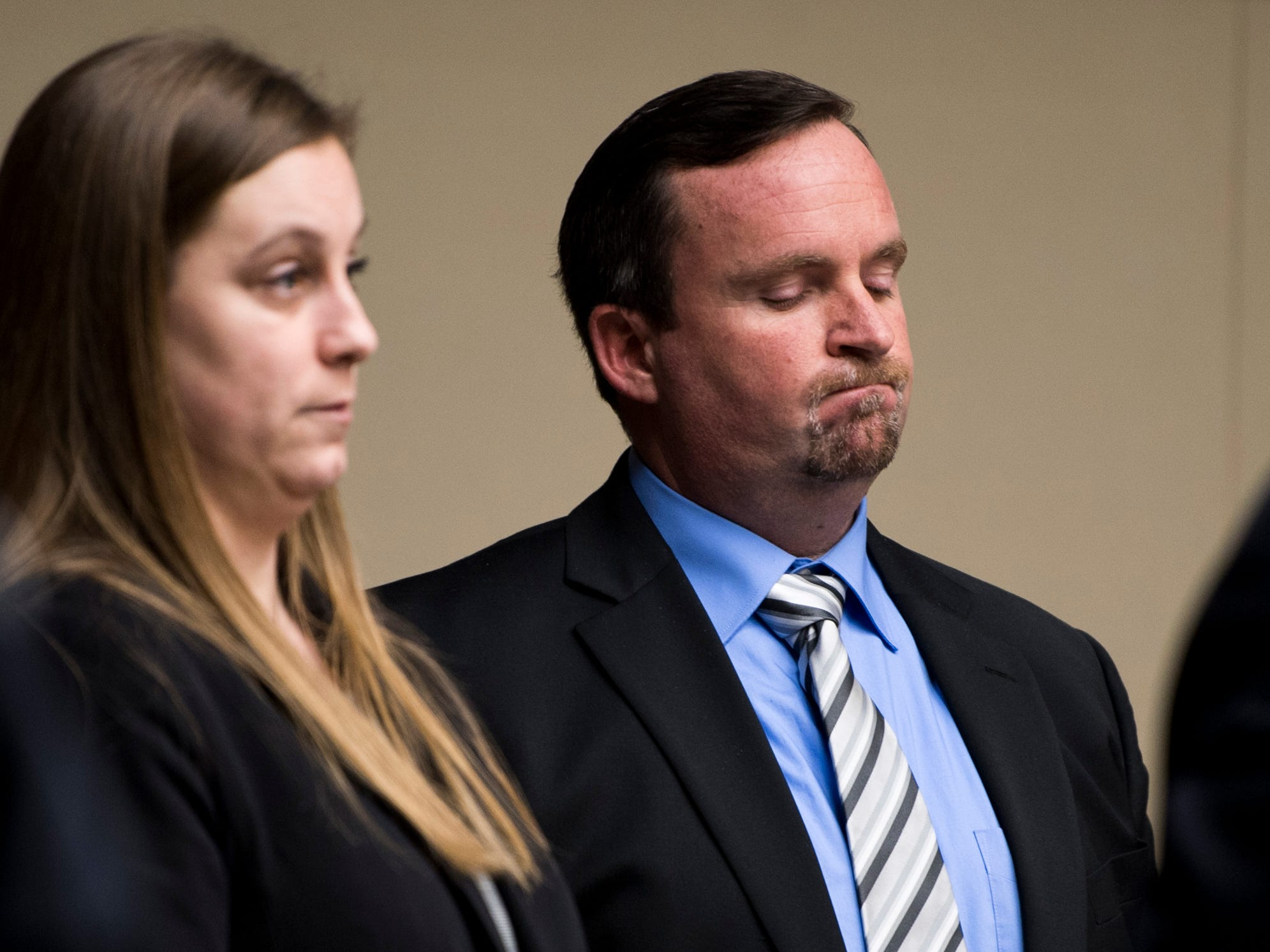 David Lynn Richards, right, reacts as the jury reads the verdict in Knox County Criminal Court on Monday, February 11, 2019. The jury found Richards guilty of nine felony counts, including rape, incest and sexual battery.
