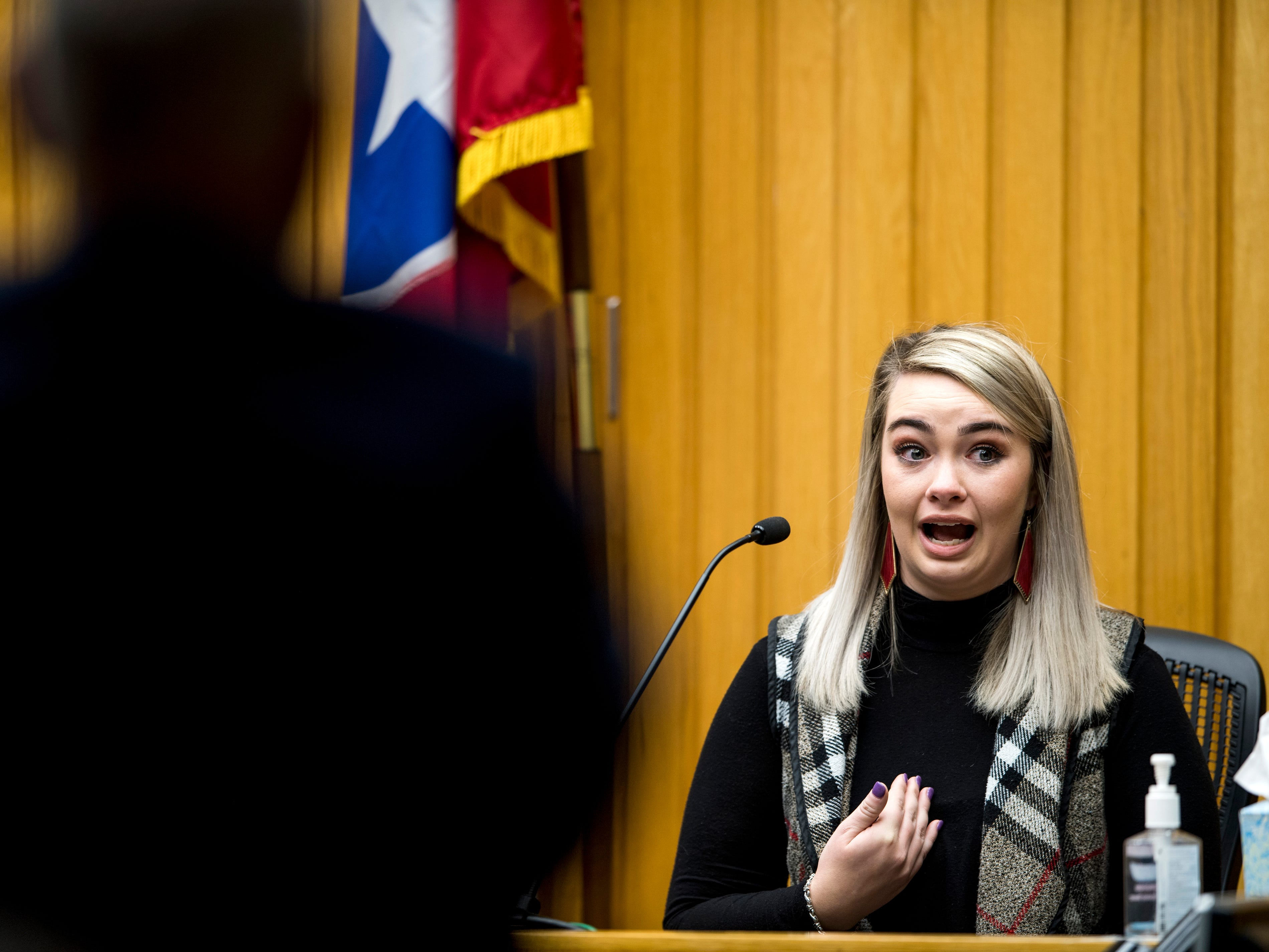 Megan Richards, the biological sister of the accuser Amber Richards, cries on the witness stand as she's questioned by  defense attorney Gregg Harrison, left, during David Lynn Richards' trial in Knox County Criminal Court on Friday, February 8, 2019.