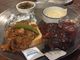 Five Oaks Farm Kitchen's Smokehouse Sampling consists of portions of smoked pork butt, beef brisket and spare ribs, plus two sides.