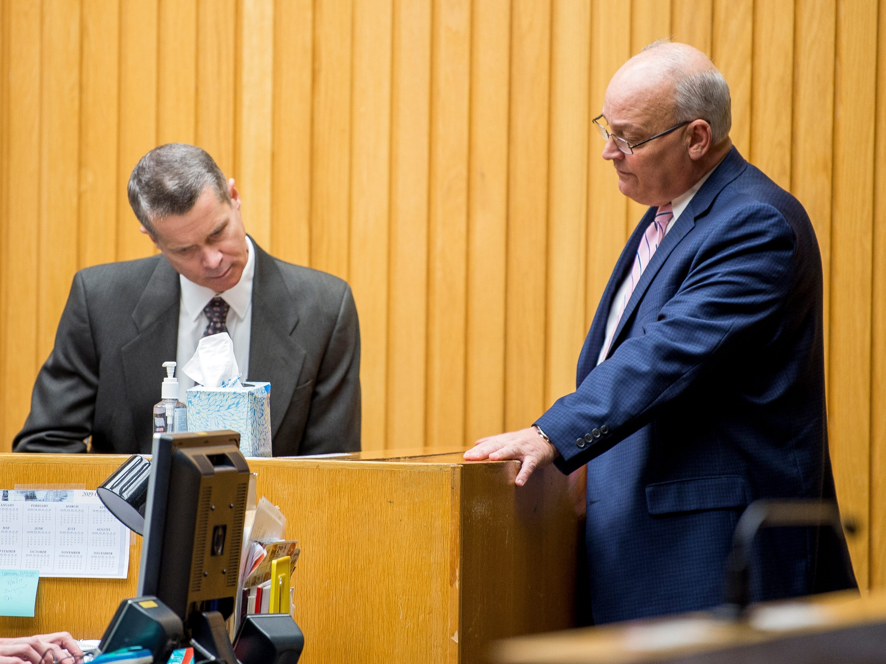 Defense attorney Gregg Harrison, right, shows KCSO's James Smithhart a document during David Lynn Richards' trial in Knox County Criminal Court on Friday, February 8, 2019.