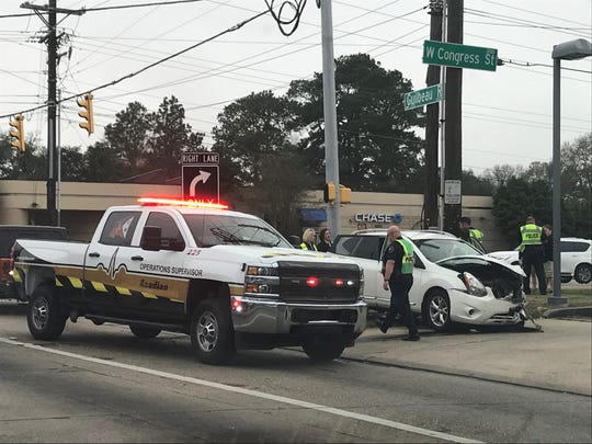 Authorities respond to a wreck on Congress Street and Guilbeau Road Monday morning.