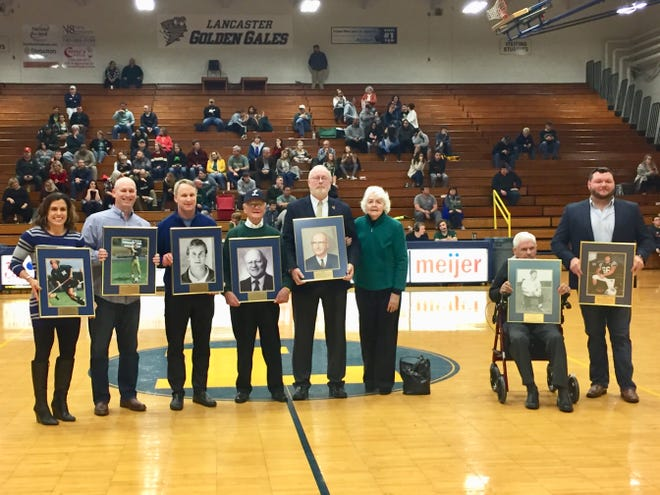 Members who were inducted into the Lancaster High School Wall of Honor were, from left to right: Marianne (Beshara) Flannery, Scott Burre, David Detwiller, Paul and Dottie Jasson, accepting for Dwight Kanem Earl Jones and Thomas Stuck.