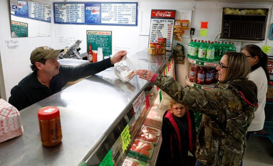 David Drumm, left, to Melody Evans Monday afternoon, Feb. 11, 2019, at Fred's Market on Reese Avenue in Lancaster.