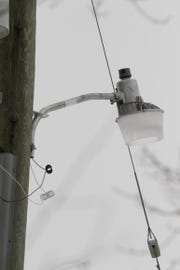 Two Marion Township neighbors on Pingree Rd. have a dispute that includes one neighbor's installing a light on a utility pole, shown Monday, Feb. 11, 2019.