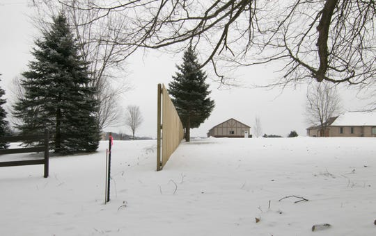 Two neighbors on Pingree Rd., shown Monday, Feb. 11, 2019, have an ongoing dispute that has escalated.