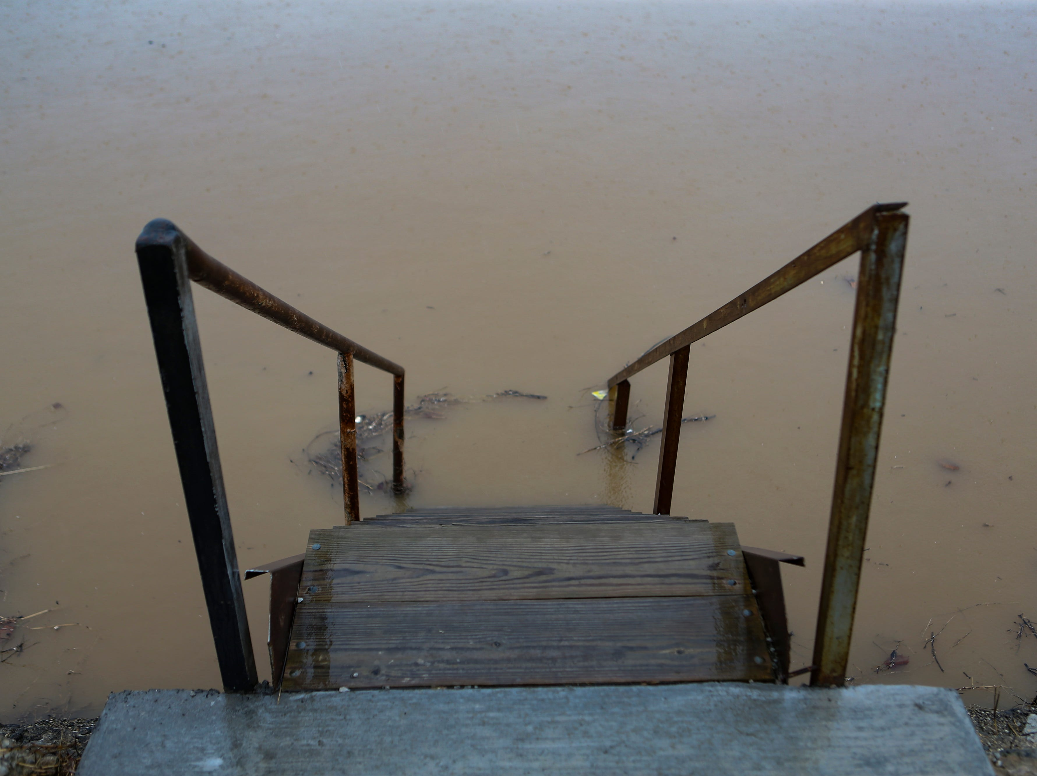Water rises up over stairways along the river in Utica, Ind. on Monday as the area braces for high river waters and flooding. Feb. 11, 2019