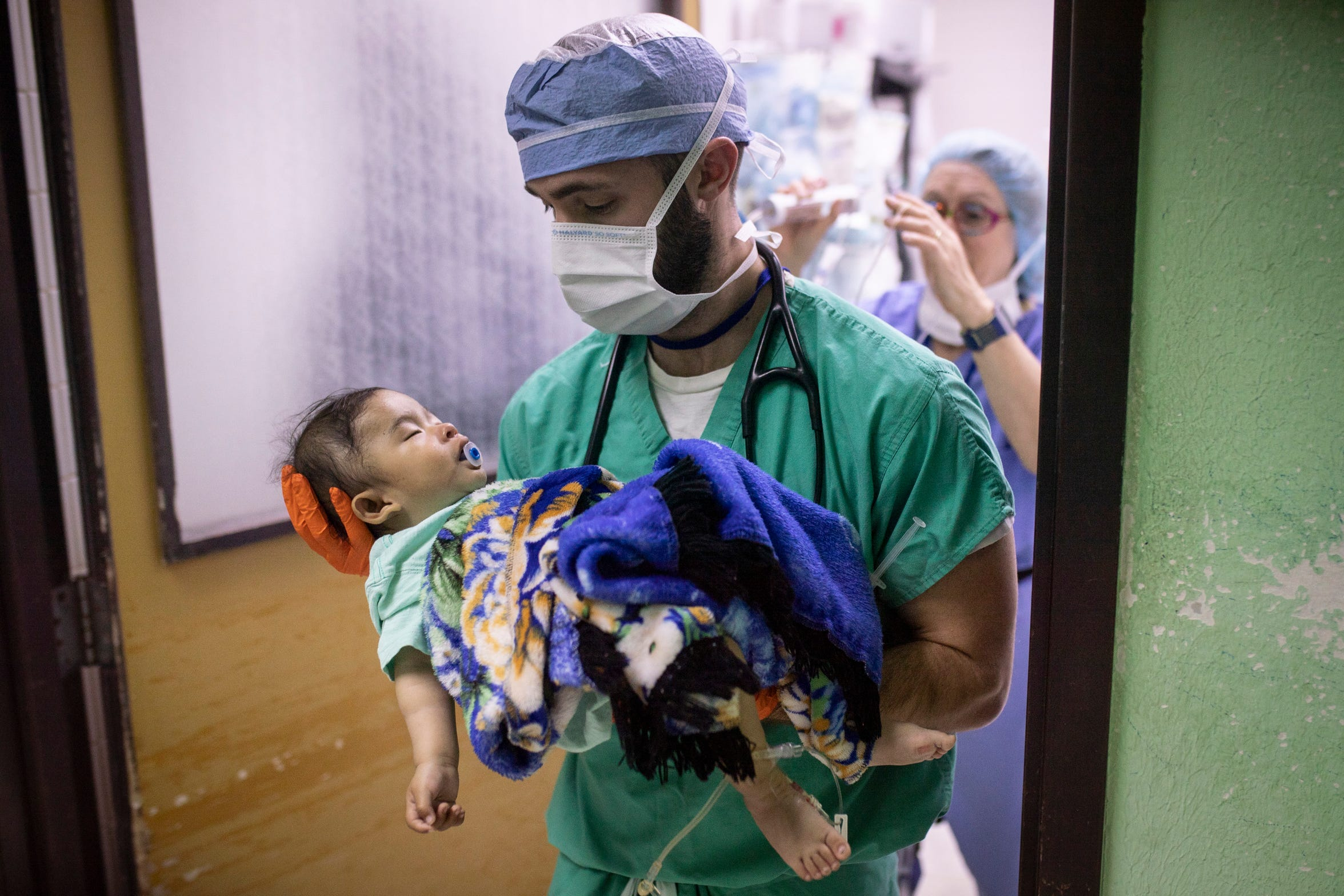 "U.K. Healthcare anesthesia resident Bryan Hardin carries a young patient out of the operating room at Hospital Nacional de Salamá. ""I wish we could be here longer,"" Hardin said. ""For them, this is a huge deal, but for us it's just a week of our lives. It gives you a lot of perspective."" Jan. 23, 2019"