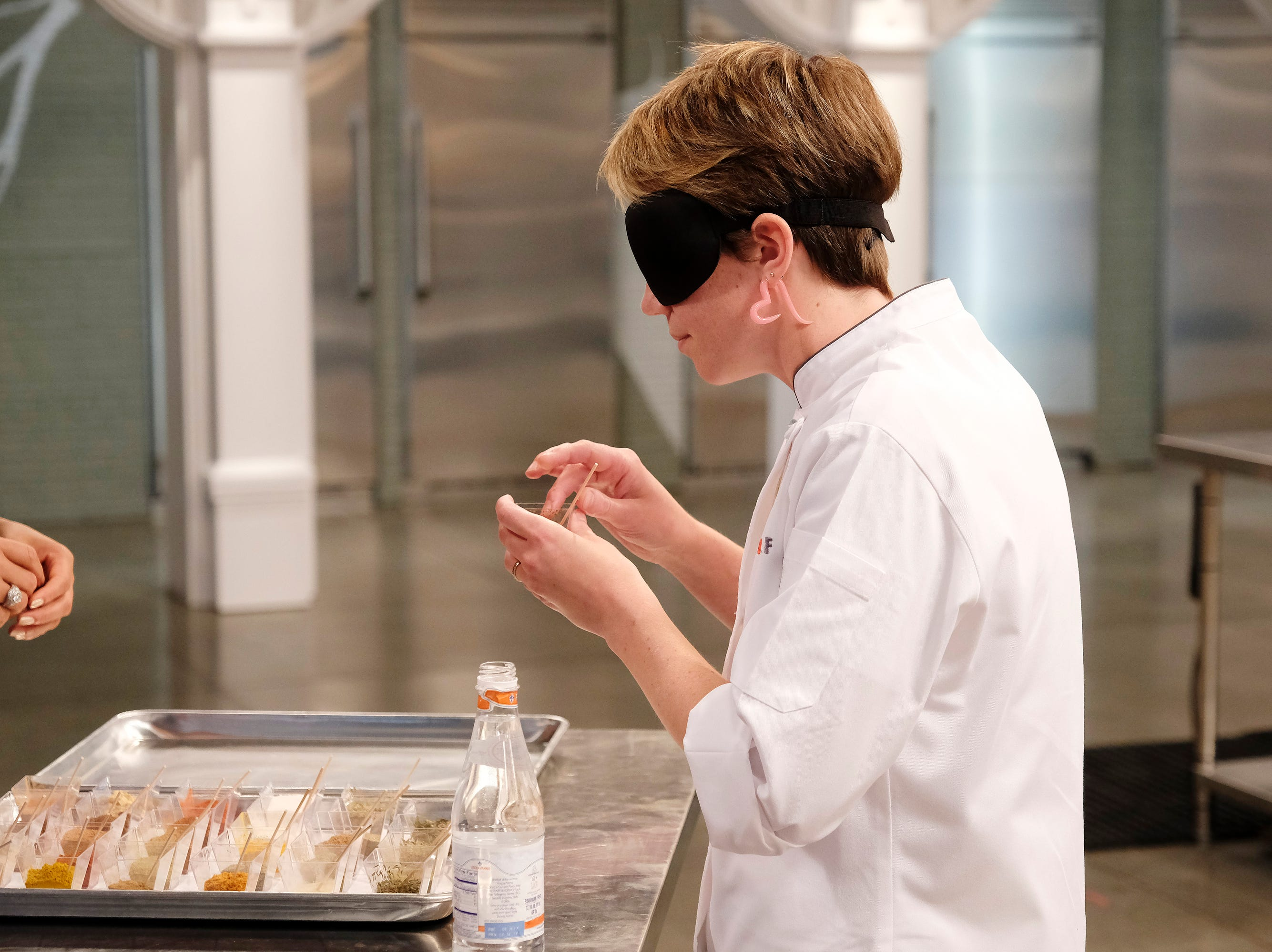 Contestant Adrienne Wright does a blind taste test on episode 11 of Bravo's 'Top Chef:' Kentucky season.