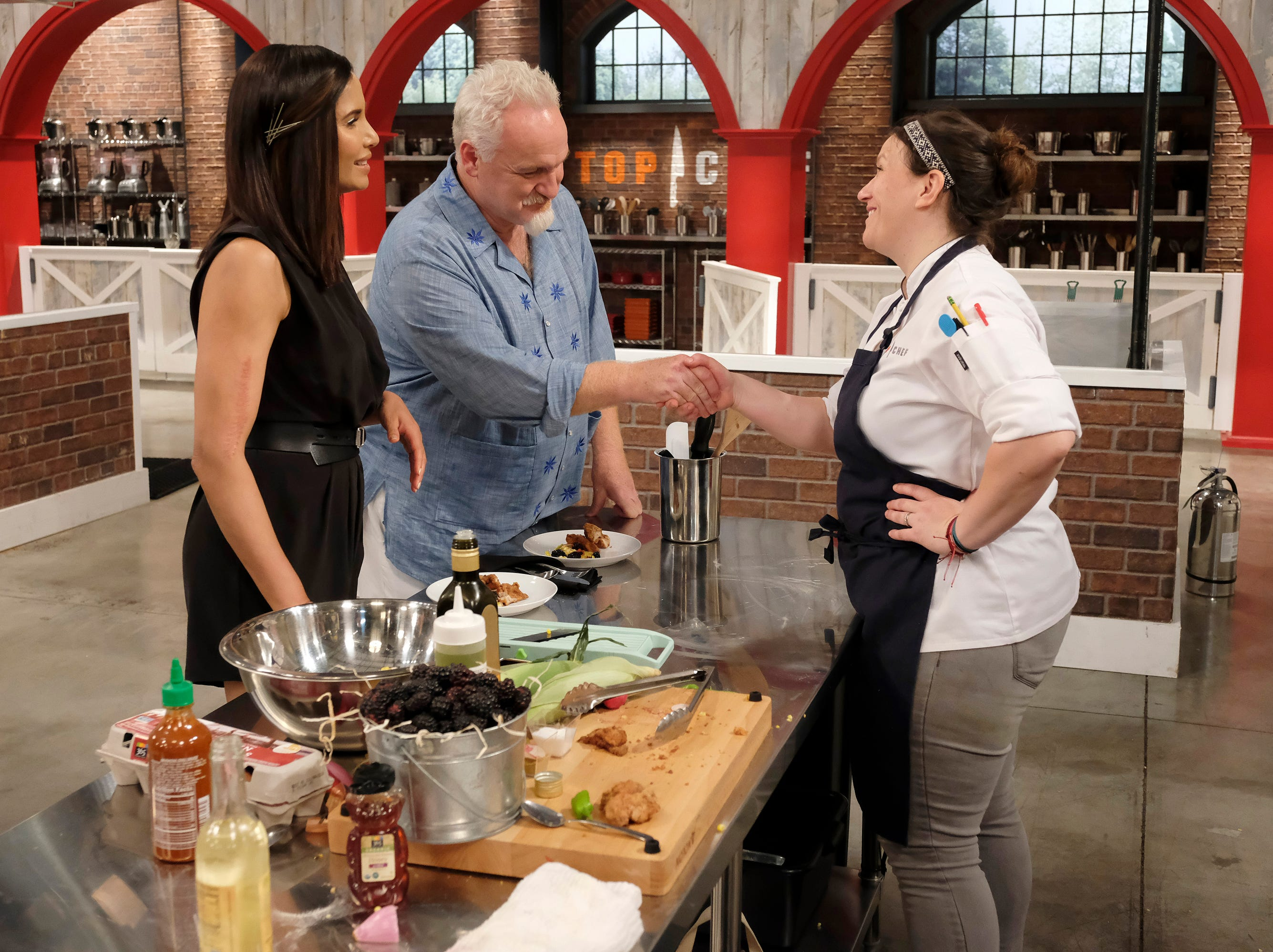 (From left to right): Host Padma Lakshmi, Chef Art Smith and contestant Sara Bradley on episode 11 of Bravo's 'Top Chef:' Kentucky season.