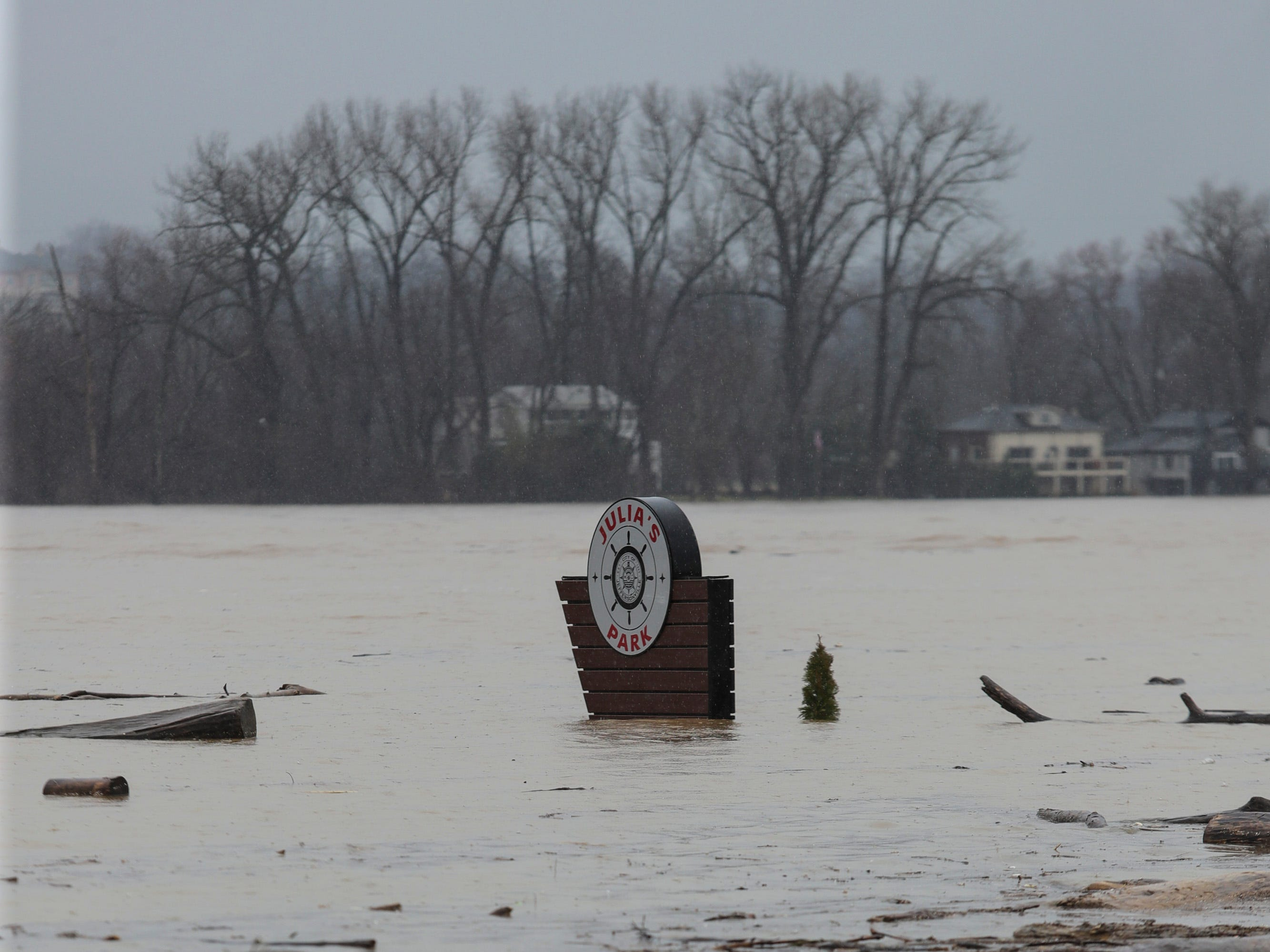 A Julia's Park sign stands flooded in Utica, Ind. as Ohio River water levels begin to rise. Feb. 11, 2019