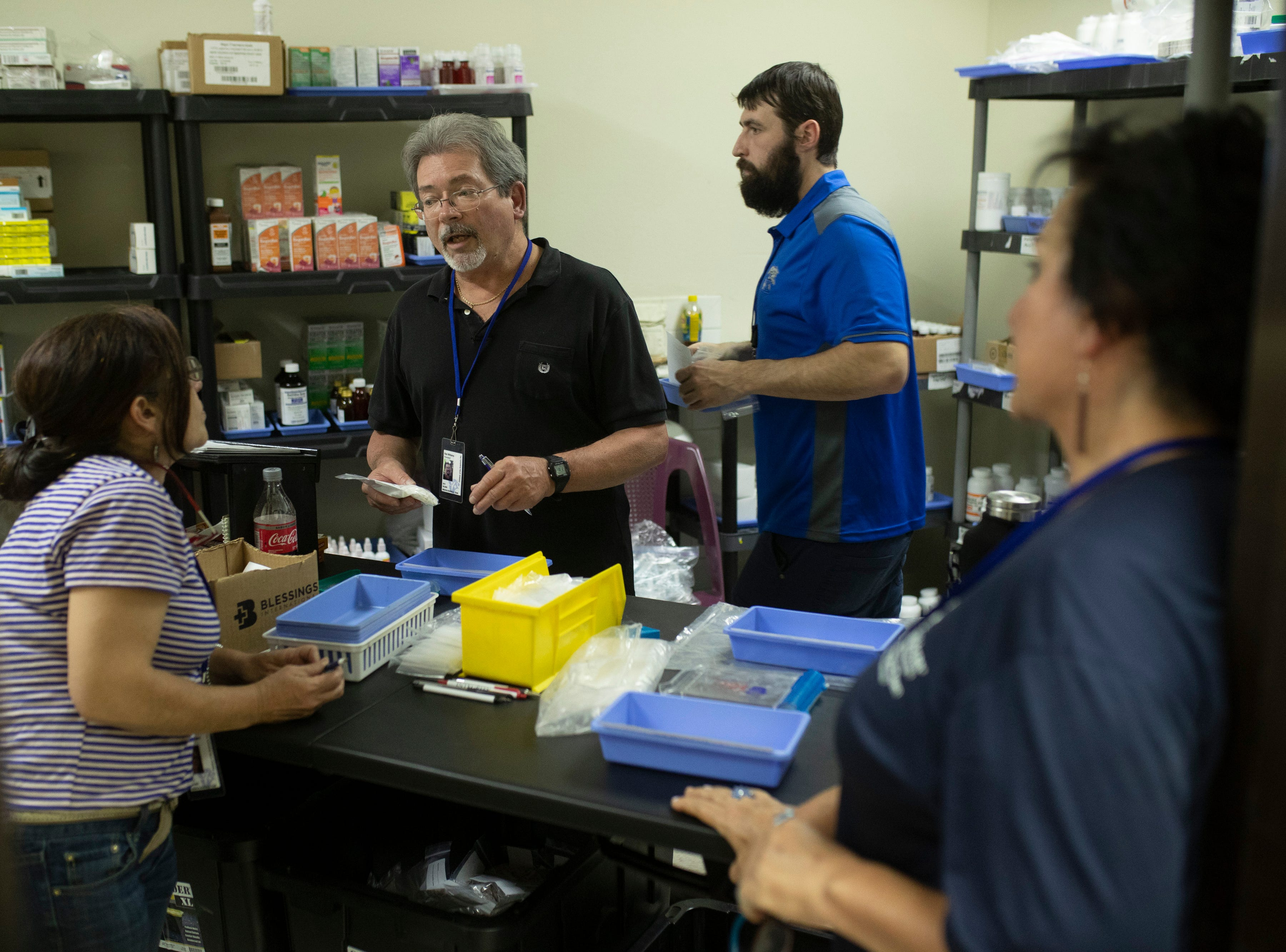 COTA pharmacist Rob Williams, PharmD, center, works on filling orders at the Hospital Nacional de Salamá. Jan. 22, 2019