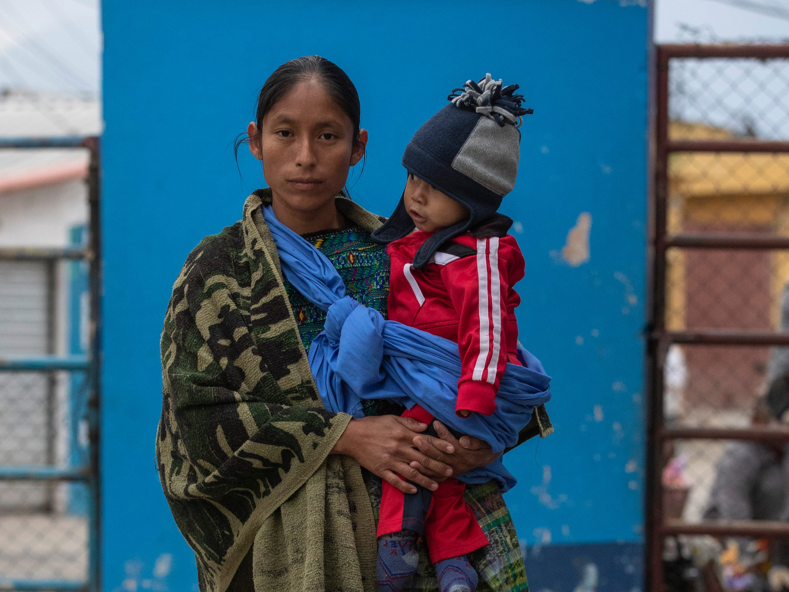 Estella Rojas - Ordoñez, left, holds her 14-month-old son, Wilfredo Vazquez Rojas, as they wait in line outside the hospital in Salamá, Guatemala. Wilfredo was born with club feet and Estella hopes that Children of the Americas' orthopedic surgeon, Dr. George Quill, will be able to see him and correct it. Jan. 20, 2019