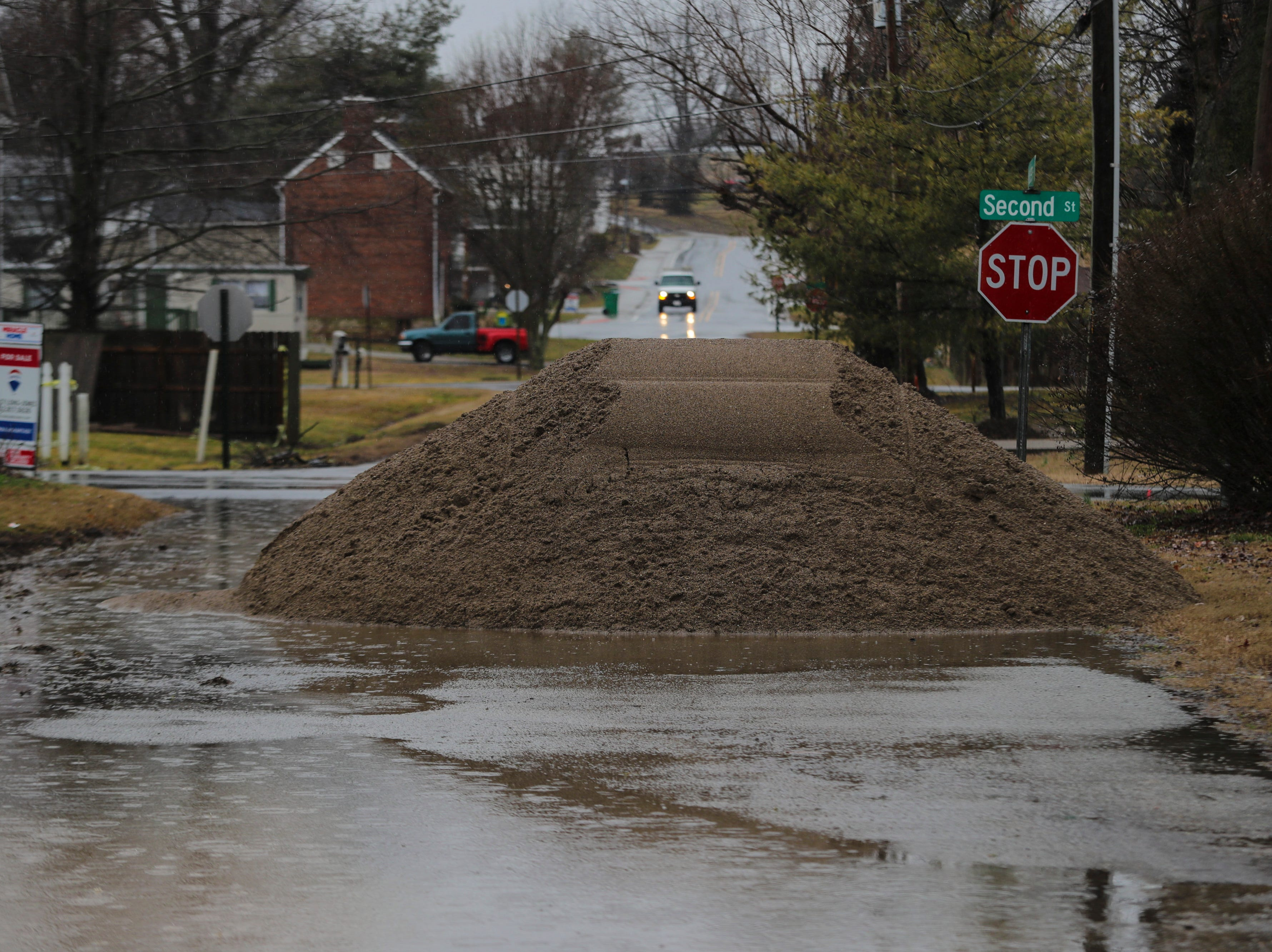 A pile of sand sits waiting to be covered in Utica, Ind. as Ohio River water levels begin to rise. Feb. 11, 2019