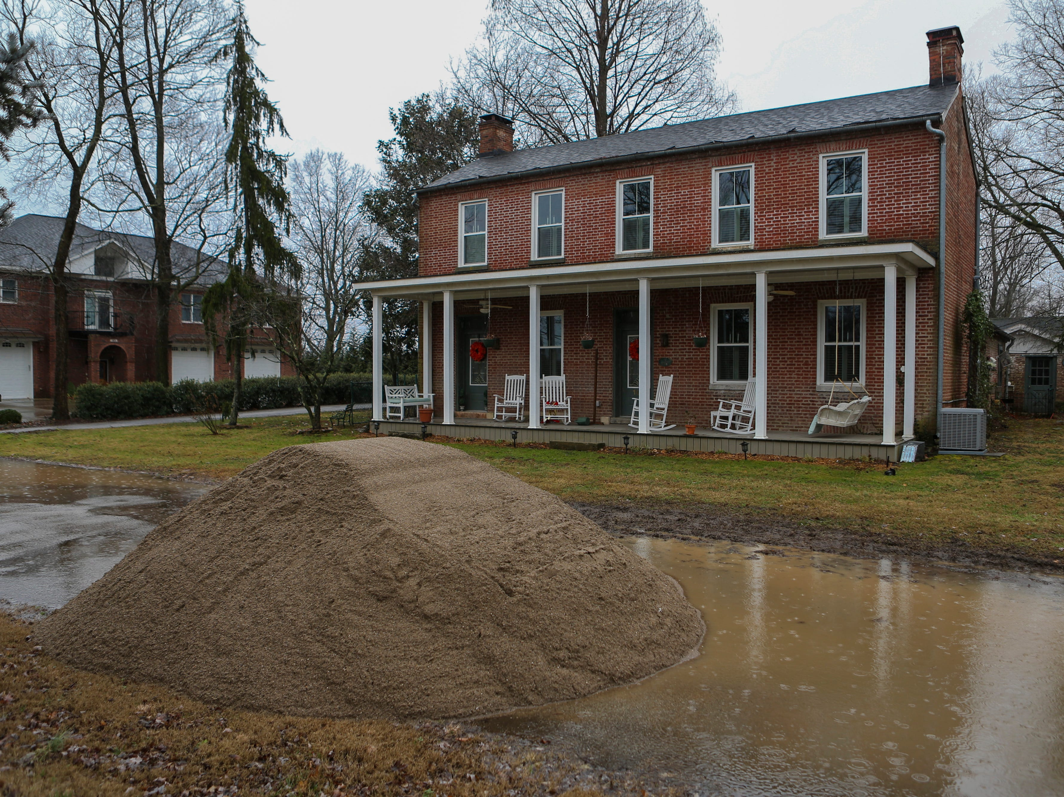 A pile of sand waits to be covered on the roads in Utica, Ind. on Monday as the area braces for high river waters and flooding. Feb. 11, 2019