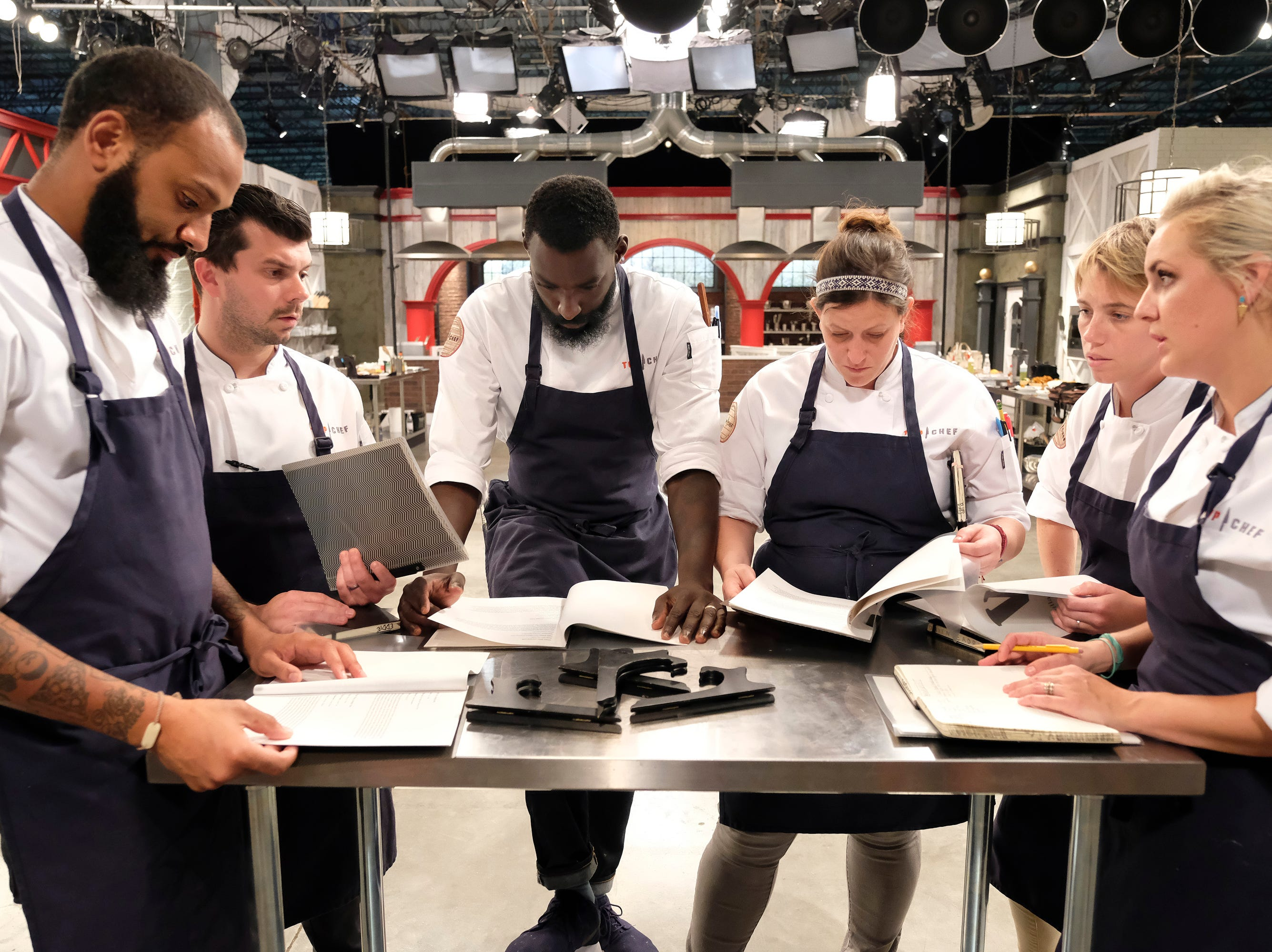(From left to right): Contestants Justin Sutherland, Eddie Konrad, Eric Adjepong, Sara Bradley, Adrienne Wright and Kelsey Barnard on episode 11 of Bravo's 'Top Chef:' Kentucky season.