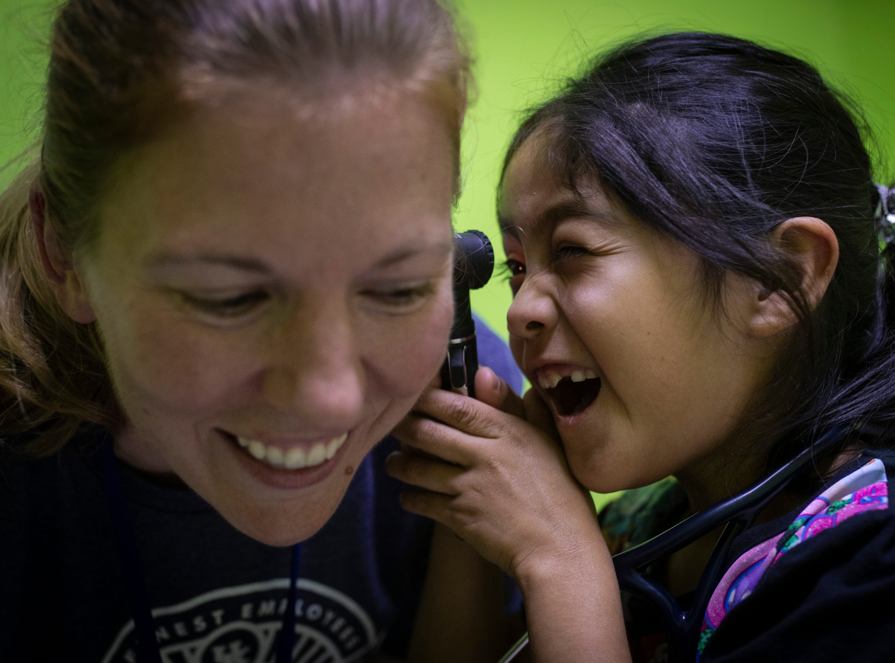 U.K. Healthcare's Dr. Heidi Frazier, left, has a laugh as patient Clara Maribel Caal Sep. 8, gives her a check-up of her own. Jan. 22, 2019
