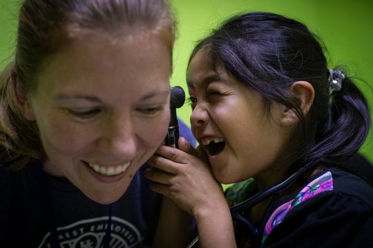 U.K. Healthcare's Dr. Heidi Frazier, left, has a laugh as patient Clara Maribel Caal Sept. 8, gives her a check-up of her own. Jan. 22, 2019