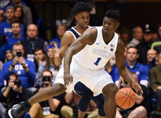 Duke Blue Devils forward Zion Williamson (1) controls the ball in front of Georgia Tech Yellowjackets forward Khalid Moore (12) during the first half at Cameron Indoor Stadium in Durham, North Carolina, on Saturday, Jan. 26, 2019.