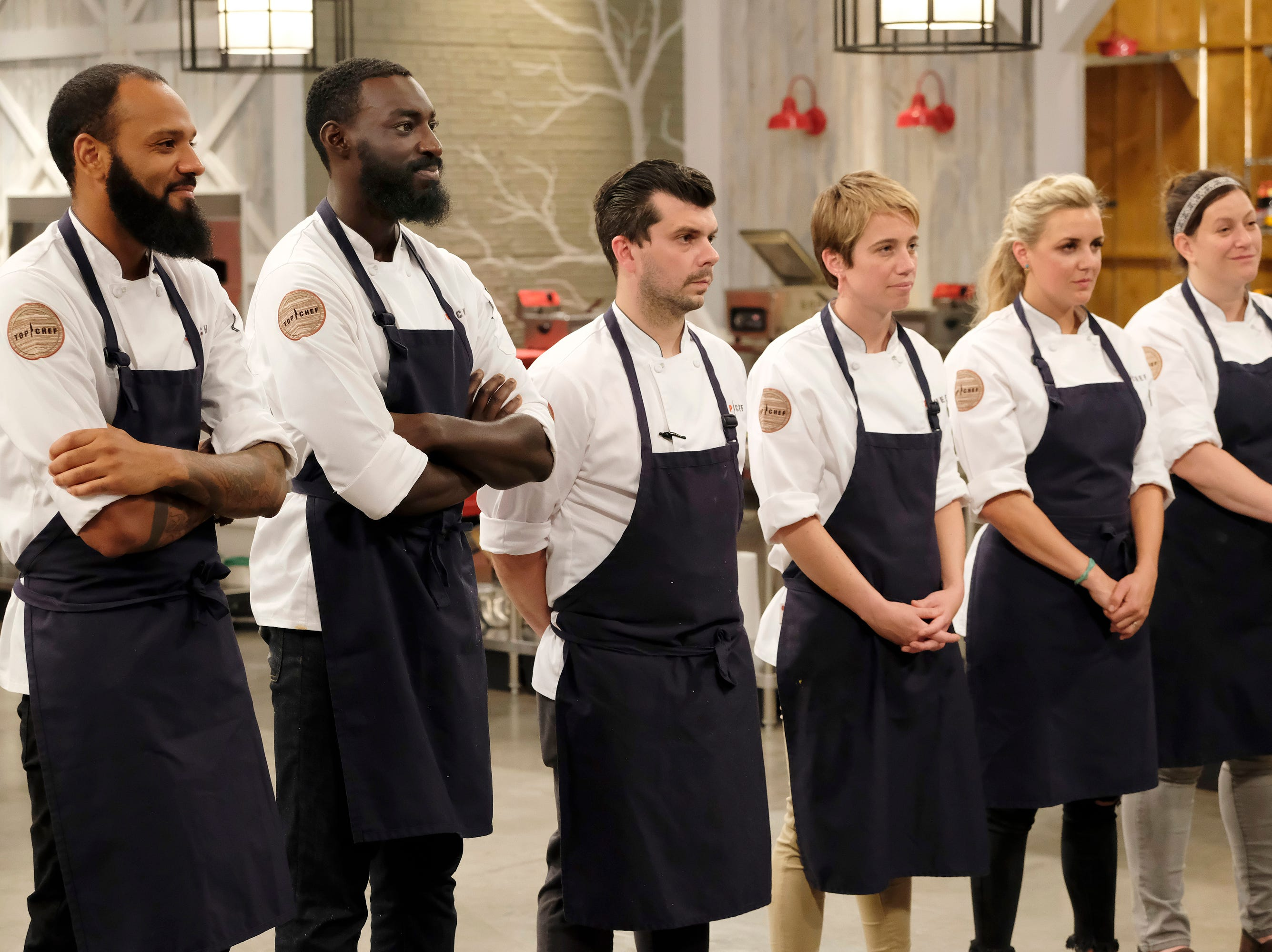 (From left to right): Contestants Justin Sutherland, Eric Adjepong, Eddie Konrad, Adrienne Wright, Kelsey Barnard and Sara Bradley on episode 11 of Bravo's 'Top Chef:' Kentucky season.