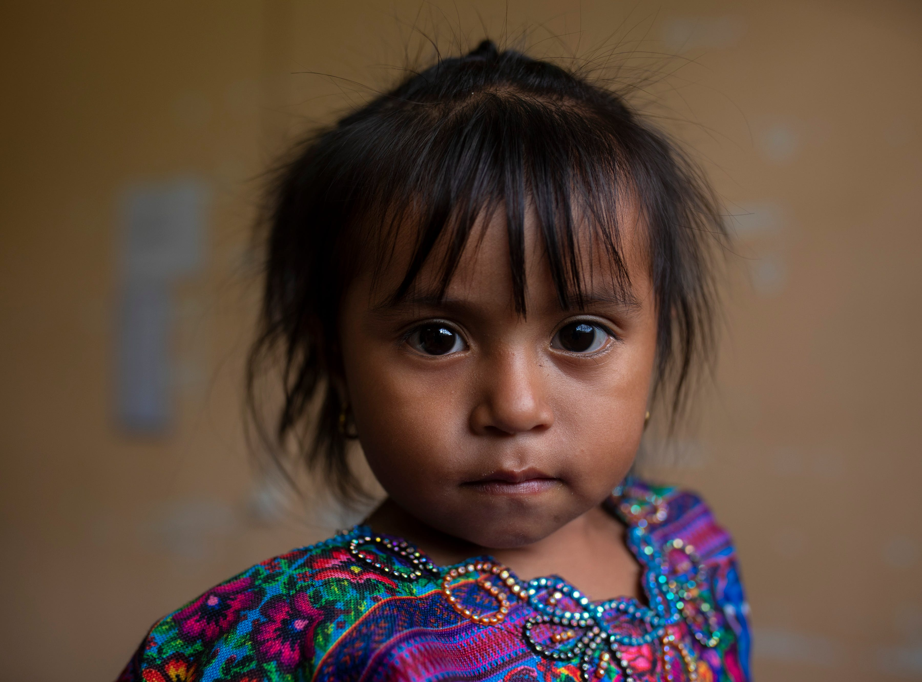 Kristel Cecilia Ordoñez, 3, looks on as she waits to see a COTA physician about a cough. Jan. 20, 2019