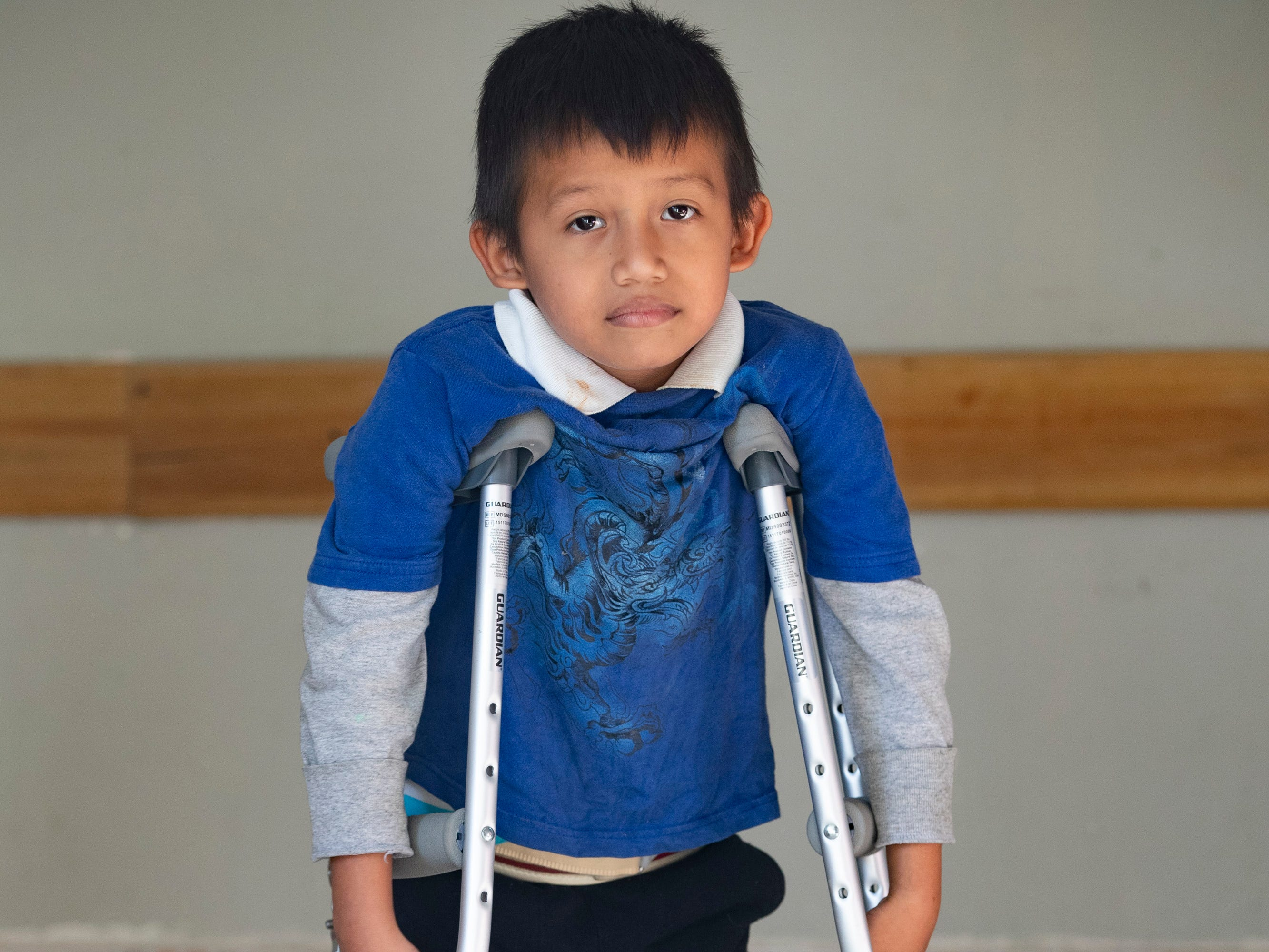 Angel Esthibon Kecinos Pedr, 7, stands with his new crutches at the National Salamá Hospital. Jan. 22, 2019