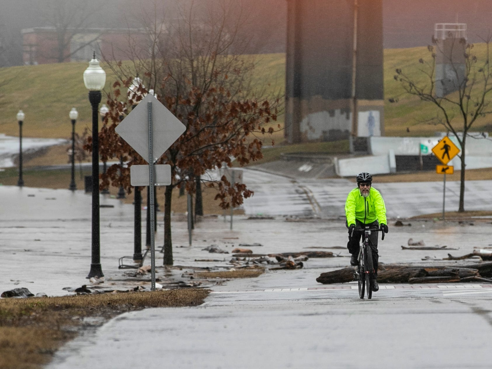 The Ohio River creeps up onto Riverside Drive in New Albany, flooding the walkway as well as part of the road. Monday. Feb. 11, 2019