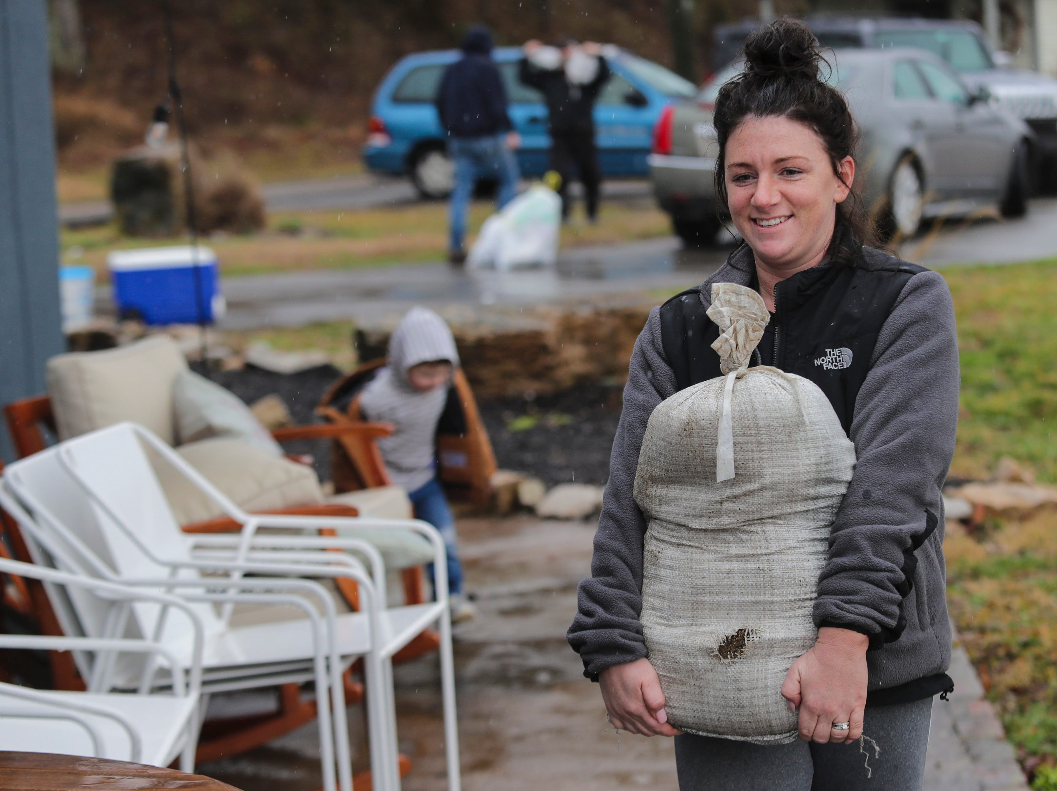 """""""I'm used to it. I grew up on the river,"""" Maggie Moore said as she carried sandbags into a home in Utica, Ind.. """"It's just a part of river life."""" Ohio River water levels are expected to hit 30 feet in the coming days. Feb. 11, 2019"""