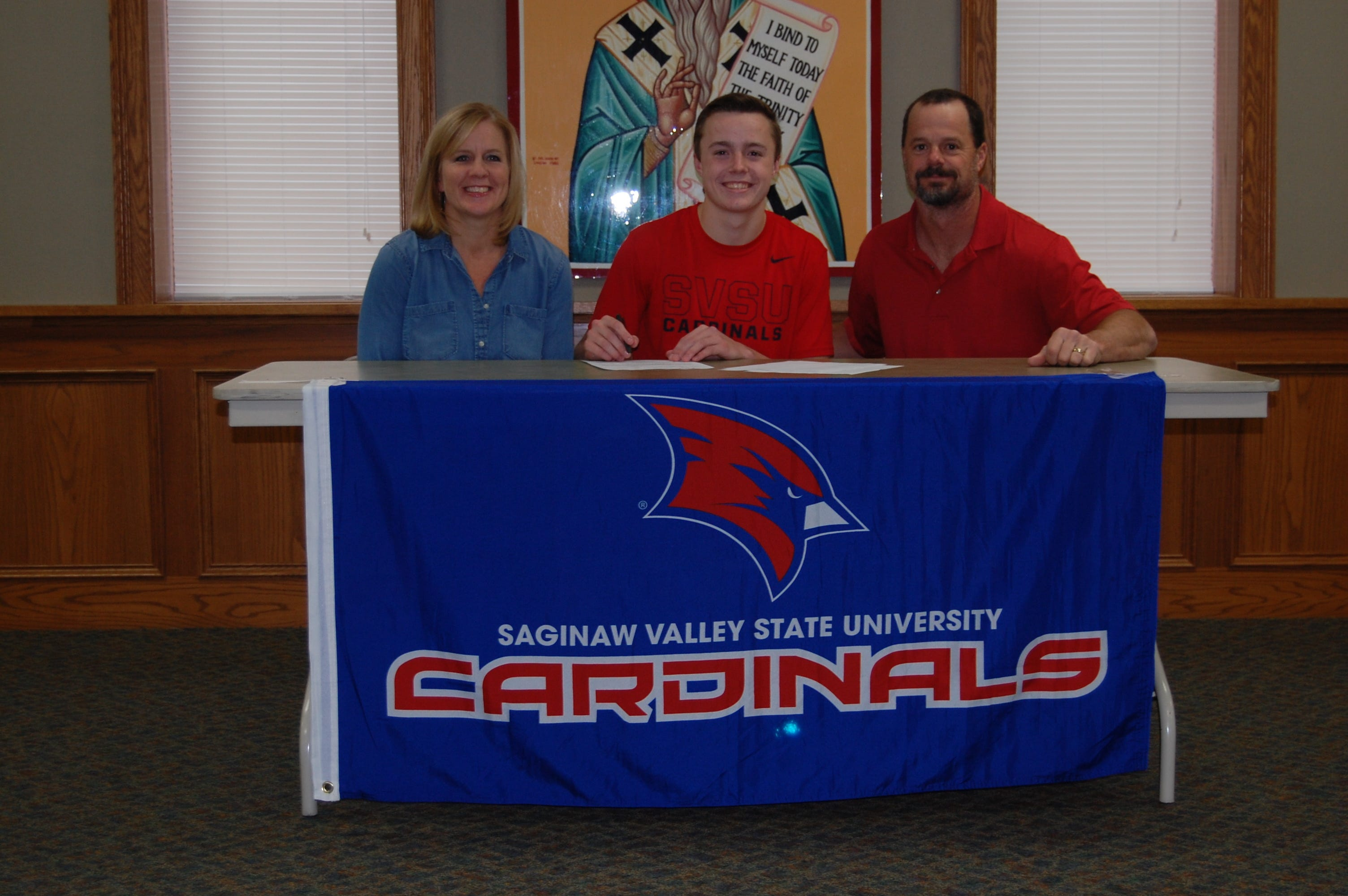 Brandon Scheurer, a senior at Portland St. Patrick School, sitting with parents Jill and Mark, signed late last year a letter of intent to play baseball at Saginaw Valley State University. He remains committed to the school.