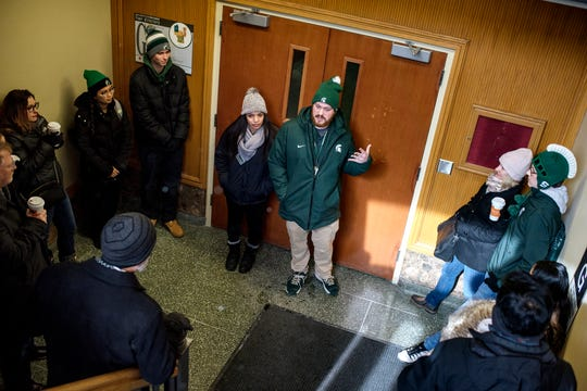 Student tour guides Brooklyn Narvaez, left, and Brendan Skopczynski, right, talk to prospective students and their family members inside the MSU Union during a walking tour of the campus on Friday, Feb. 8, 2019, in East Lansing.