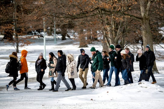 A group of prospective students and their parents are led thought the campus by student guides during a walking tour of the Michigan State University campus on Friday, Feb. 8, 2019, in East Lansing.