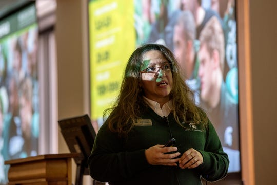 Lucinda Briones, assistant director of admissions at Michigan State University, speaks to prospective students before a walking tour of the campus on Friday, Feb. 8, 2019, in East Lansing.
