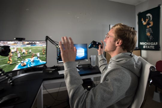 "Matt Meagher celebrates a touchdown Feb. 4, 2019, while playing Madden 19 online. ""I am 100 percent me when I'm on here,"" The MSU junior studies marketing, and is the president of his fraternity Psi Upsilon, he also records himself playing the video game Madden 19 and posts them on YouTube. He has nearly 1 million subscribers."