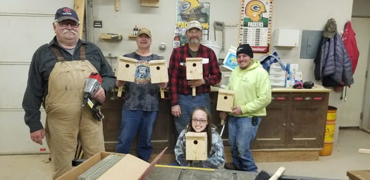 Maribel Sportsmen's Club and Francis Creek Sportsmen's Club members have been busy building wood duck and bluebird houses for the public. Showing the bluebird houses after an assembly night are, from left: Glen Vandenhouten, Greg Mitchell, Bill Mechaand Curt Biely with Ashley Schuh kneeling.