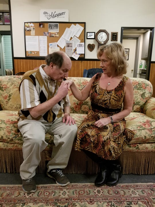 "Jim Liddle as ""Bud 'the Stud' Davis"" shares a romantic moment with Victoria Ambrose, played by Cindy Bradley, in The Masquers' ""Sex Please, We're Sixty."""