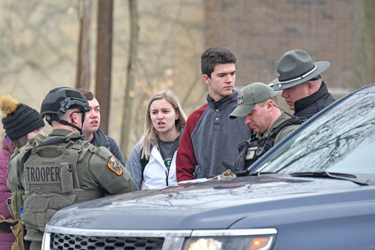 Students from The Ohio State University at Mansfield answer questions from law enforcement Monday afternoon after a student was abducted on campus.