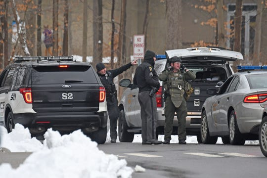 Law enforcement assemble on the campus of The Ohio State University at Mansfield on Monday after a student was abducted in the morning.